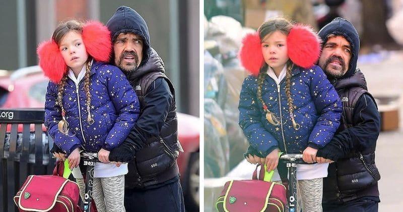 Peter Dinklage sõidab koos 6-aastase tütrega motorolleriga New Yorki kaudu, kuna ta hoiab end tohutult punastes kõrvaklappides soojana